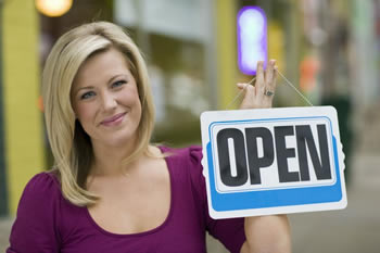 Women Entrepreneur holding open sign
