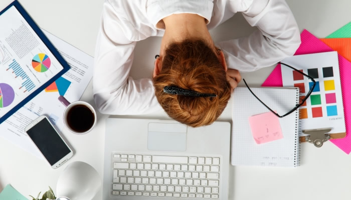 Entrepreneur Sleeping at Desk