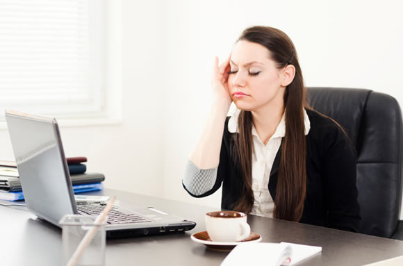 Woman stressed working at the computer